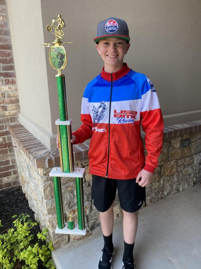 Carson Lackey holds his 1st place trophy from Cajuns USA BMX National Event.