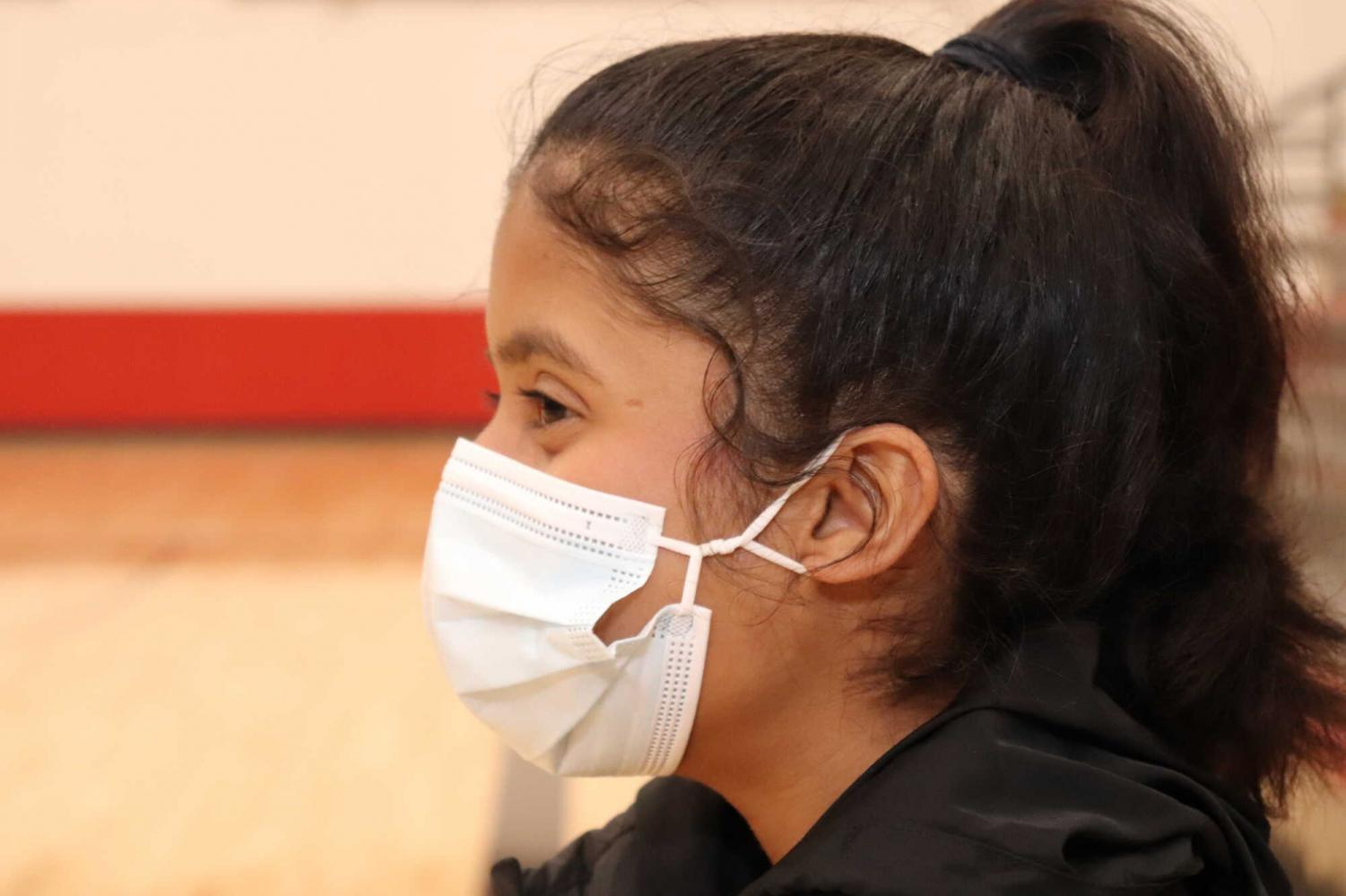 Faith Thejus wears a mask in the YMS gym.